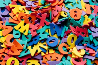 Random pile of colourful plastic letters